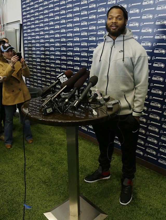 Seattle Seahawks defensive end Michael Bennett talks to reporters Monday, March 10, 2014, at the team's headquarters in Renton, Wash. The Seahawks announced Monday that Bennett, who was one of the top NFL football free agents this year, had signed a multi-year deal with the Super Bowl champion Seahawks. (AP Photo/Ted S. Warren)