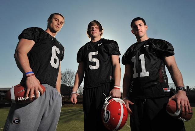 FILE - In this Feb. 26, 2010, file photo, Georgia quarterbacks Logan Gray (6), Zach Mettenberger (5) and Aaron Murray (11) pose for a photo in Athens, Ga. After taking a circuitous and sometimes troubled route from Georgia to junior college and now LSU, Mettenberger is headed back to Athens, where his mom still works in the Bulldogs' football office. (AP Photo/Atlanta Journal Constitution, Brant Sanderlin, File)