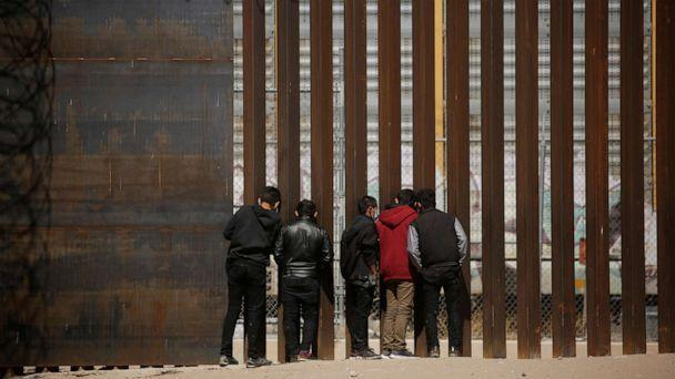 PHOTO: Migrants look through the border wall after crossing the Rio Bravo river to turn themselves in to U.S. Border Patrol agents and request asylum in El Paso, Texas, U.S., as seen from Ciudad Juarez, Mexico March 14, 2021.  (Jose Luis Gonzalez/Reuters)