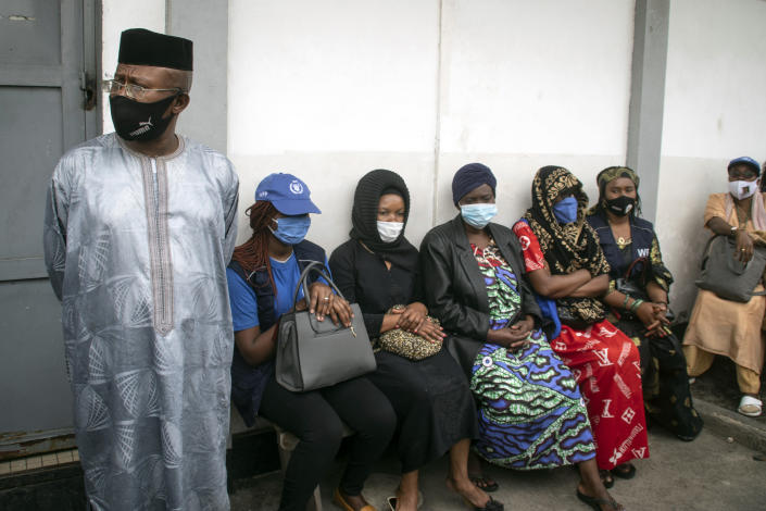 The family of World Food Programme (WFP) driver Moustapha Milambo, who was killed in the attack on a U.N. convoy that also killed the Italian ambassador to Congo and an Italian Carabinieri police officer, wait to receive his body at the morgue in Goma, North Kivu province, Congo Tuesday, Feb. 23, 2021. An Italian Carabinieri unit is expected in Congo Tuesday to investigate the killings of the Italian ambassador to Congo, an Italian Carabinieri police officer and their driver in the country's east. (AP Photo/Justin Kabumba)