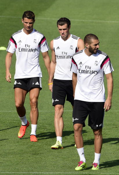 (From L) Real Madrid's Cristiano Ronaldo, Gareth Bale and Karim Benzema, pictured during a training session in Madrid, on August 18, 2014, on the eve of their Spanish Super Cup match against Atletico Madrid (AFP Photo/Gerard Julien)