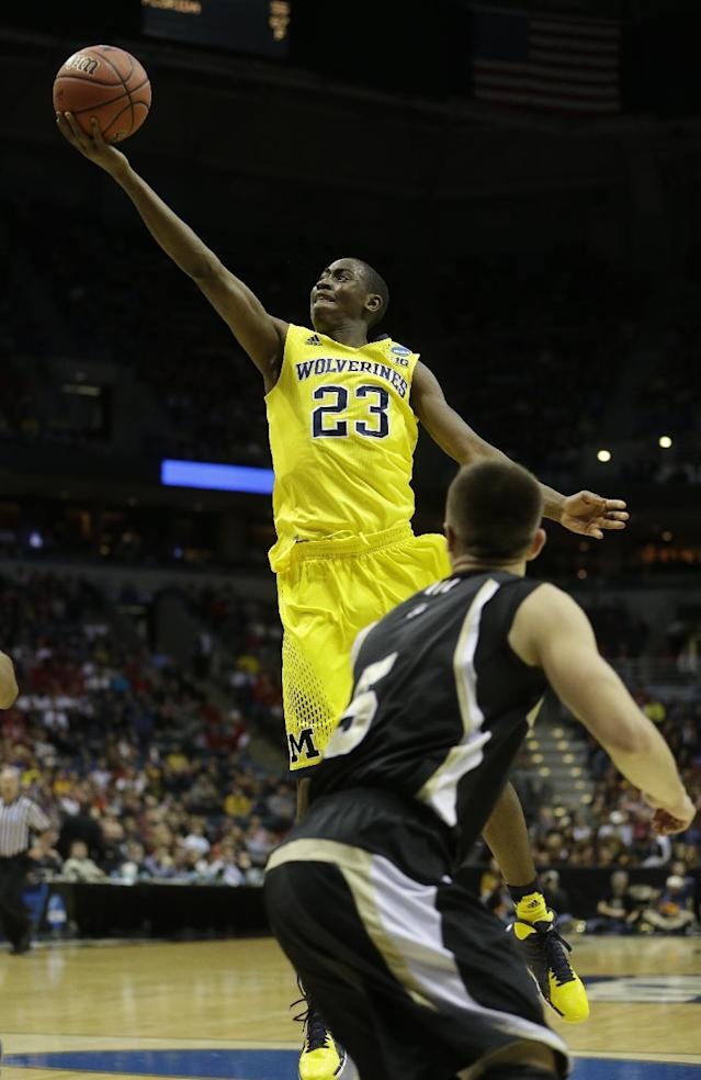 Michigan guard Caris LeVert (23) drives to the basket during the first half of a second round NCAA college basketball tournament game against the Wofford Thursday, March 20, 2014, in Milwaukee. (AP Photo/Morry Gash)