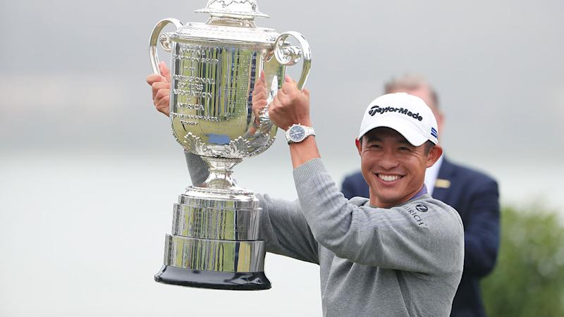 Pictured here, Collin Morikawa hoists the PGA Championship trophy aloft.