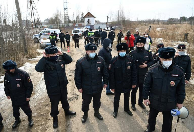 Russian police officers on Tuesday guard the entrance to the penal colony where Kremlin critic Alexei Navalny is being held