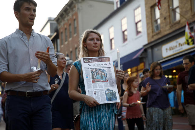 <p>Mourners walk during a vigil in response to a shooting at The Capital Gazette newspaper office, Friday, June 29, 2018, in Annapolis, Md. (Photo: Patrick Semansky/AP) </p>