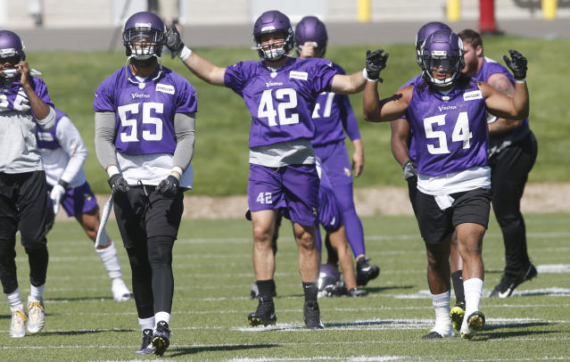 Minnesota Vikings linebackers Anthony Barr (55), Ben Gedeon (42) and Eric Kendricks (54) warm up during practice at the NFL football team's training camp in Eagan, Minn., Wednesday, June 13, 2018. (AP Photo/Jim Mone)