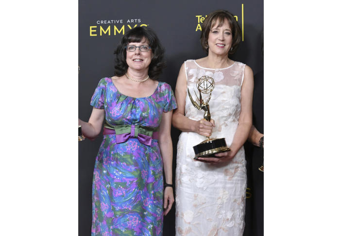 """FILE - Julie Cohen, left, and Betsy West pose in the press room with their awards for exceptional merit in documentary filmmaking for """"RBG"""" at the Creative Arts Emmy Awards in Los Angeles on Sept. 14, 2019. Their latest project, """"My Name is Pauli Murray"""" is an official selection of the Premieres section at the 2021 Sundance Film Festival. (Photo by Richard Shotwell/Invision/AP, File)"""