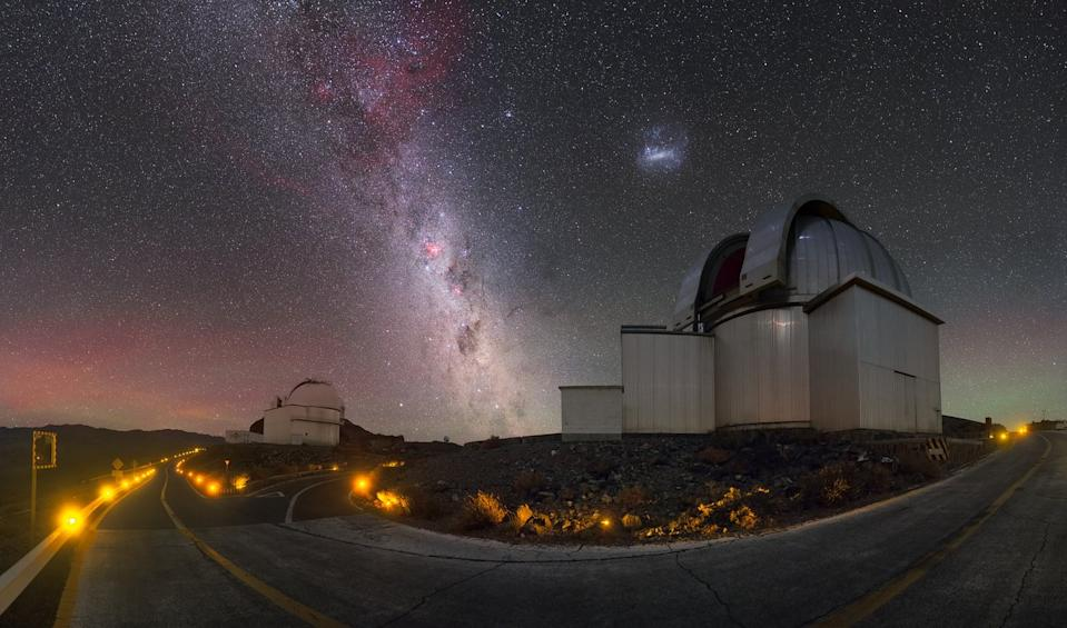 The Milky Way galaxy and one of its cosmic neighbors shimmer over the La Silla Observatory in Chile in this night sky photo by European Southern Observatory photographer Petr Horálek. That galactic neighbor is a  dwarf galaxy known as the Large Magellanic Cloud, and directly beneath it is the 7-foot (2.2 meters) MPG-ESO telescope, which scans the cosmos for high-energy gamma ray bursts, or the most powerful explosions in the universe. The smaller telescope on the left is the 3-foot (1 meter) Schmidt telescope, which has been studying galaxies, star clusters, dwarf planets and supernovas for nearly 50 years.