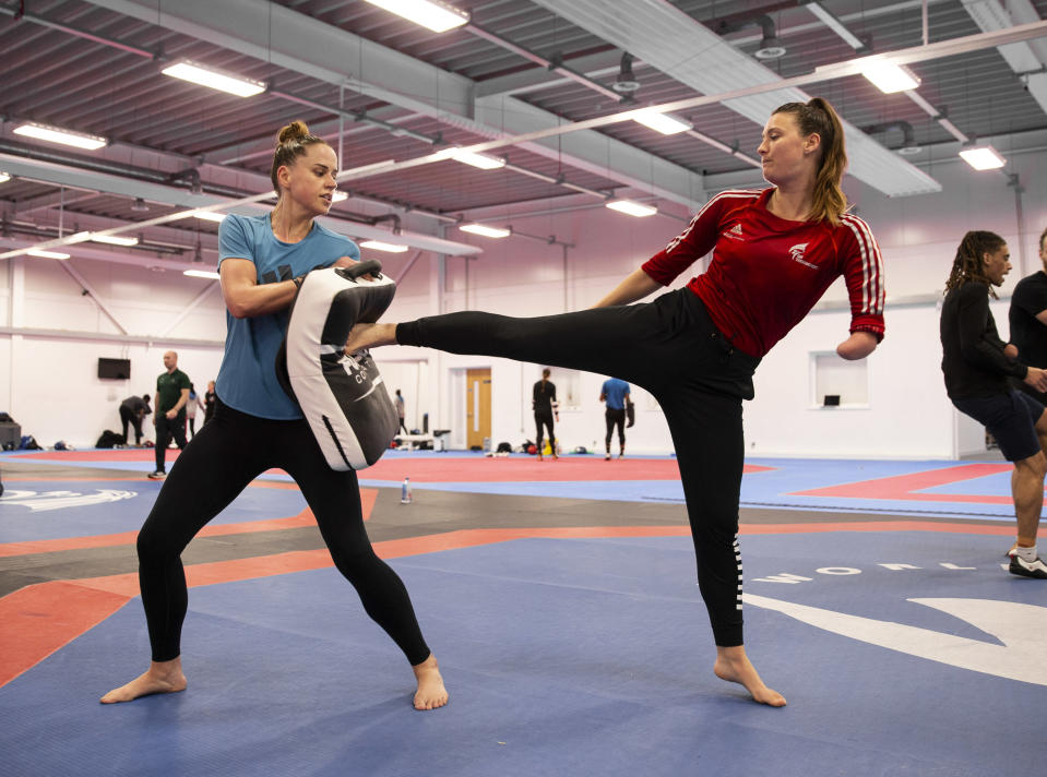 Beth Munro, left, has been inspired by taekwondo team-mate Amy Truesdale