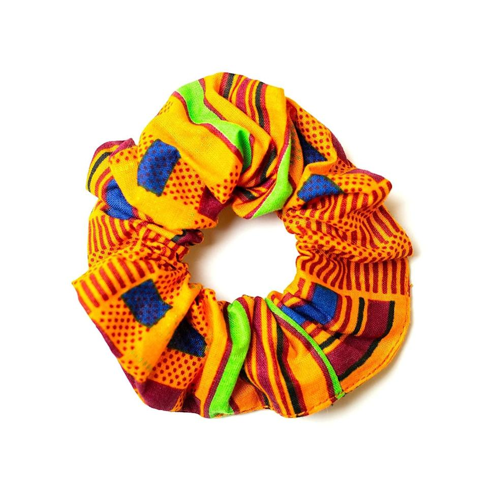 <p>Keep your hair off your face and get a cute accessory out of it. This <span>Kay Kay's Fashion Handmade Scrunchie</span> ($11) is adorable.</p>