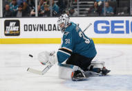 San Jose Sharks goaltender Martin Jones (31) makes a save against the Calgary Flames in the first period of an NHL hockey game in San Jose, Calif., Sunday, Nov. 11, 2018. (AP Photo/Josie Lepe)