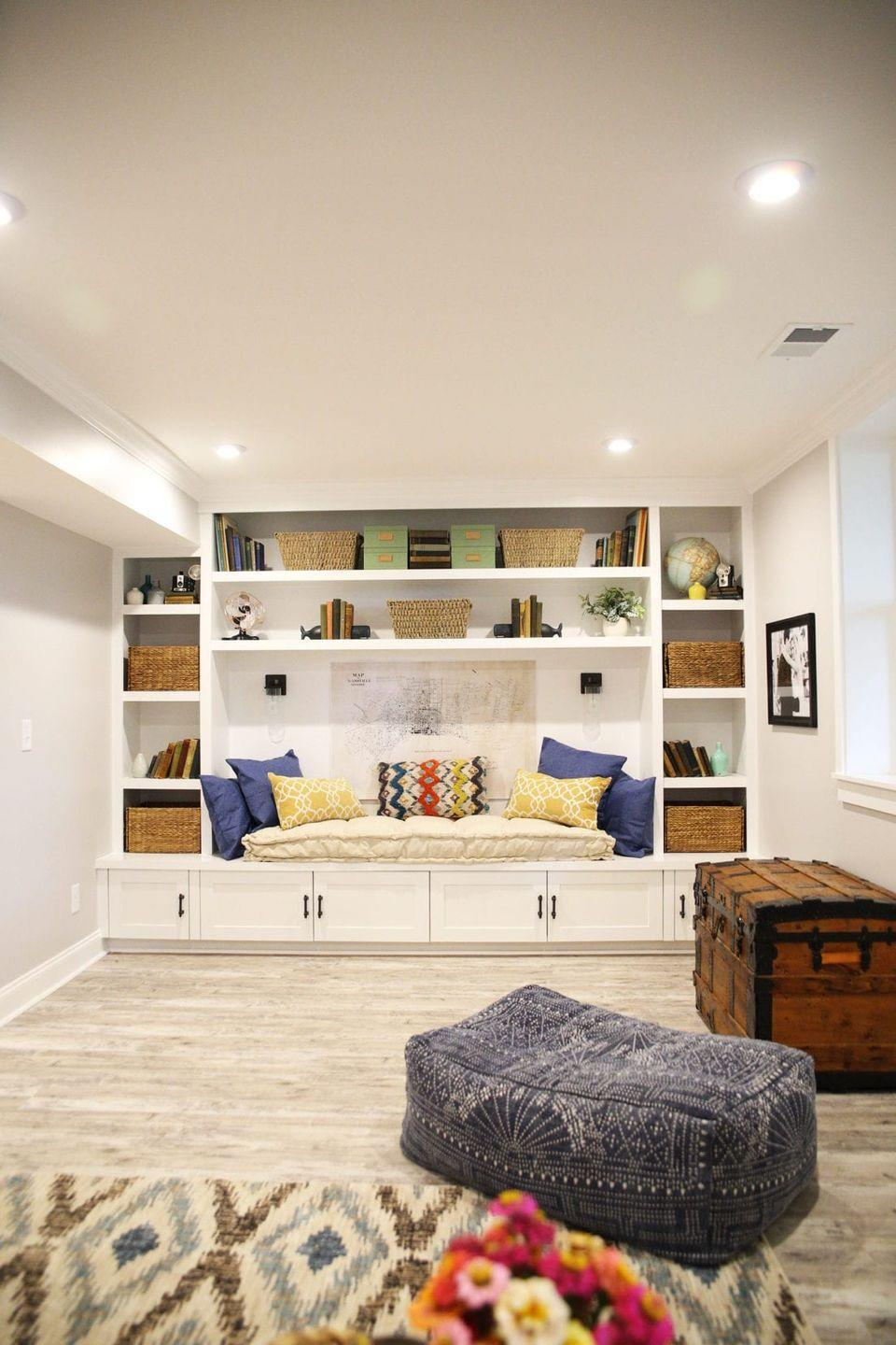 "<p>Showcase all of your favorite things with a basement featuring multiple built-in shelves. This space incorporates football relics, fun photos, vintage glasses, and other collectables for a truly unique look. Add seagrass baskets to the mix to meet all of your storage needs. </p><p><strong>See more at <a href=""https://www.thehandmadehome.net/pole-basement-reveal/"" rel=""nofollow noopener"" target=""_blank"" data-ylk=""slk:The Handmade Home"" class=""link rapid-noclick-resp"">The Handmade Home</a>. </strong></p><p><a class=""link rapid-noclick-resp"" href=""https://go.redirectingat.com?id=74968X1596630&url=https%3A%2F%2Fwww.walmart.com%2Fip%2FBest-Choice-Products-Set-of-4-Multipurpose-Stackable-Seagrass-Storage-Laundry-Organizer-Tote-Baskets-w-Insert-Handles%2F330709048&sref=https%3A%2F%2Fwww.thepioneerwoman.com%2Fhome-lifestyle%2Fdecorating-ideas%2Fg34763691%2Fbasement-ideas%2F"" rel=""nofollow noopener"" target=""_blank"" data-ylk=""slk:SHOP STORAGE BASKETS"">SHOP STORAGE BASKETS</a></p>"