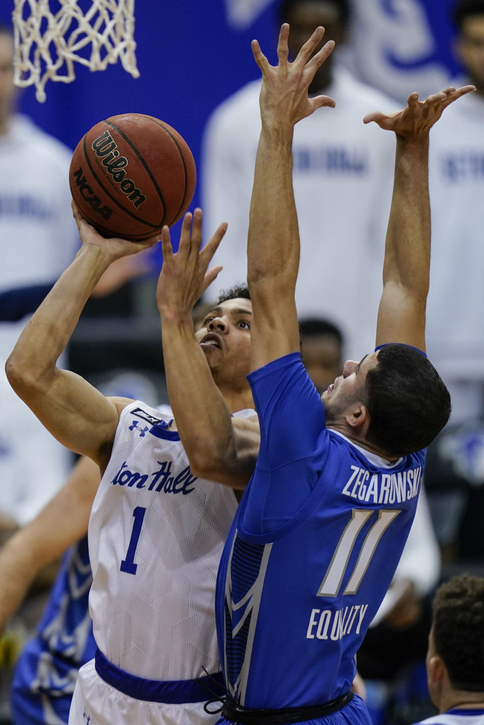 Seton Hall's Bryce Aiken (1) drives past Creighton's Marcus Zegarowski (11) during the second half of an NCAA college basketball game Wednesday, Jan. 27, 2021, in Newark, N.J. Creighton won 85-81. (AP Photo/Frank Franklin II)