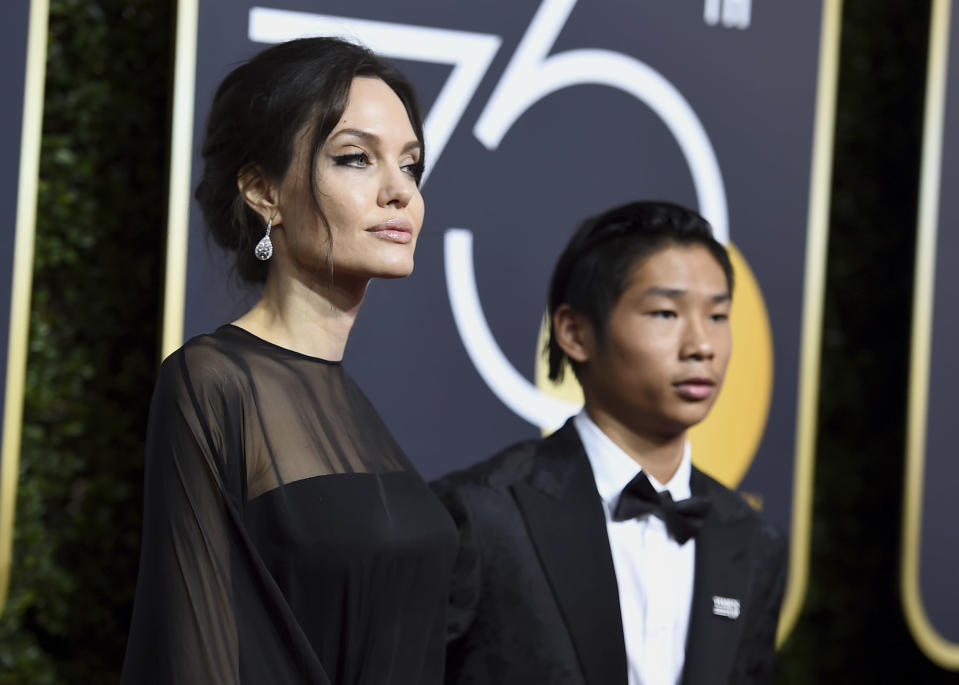 Angelina Jolie and Pax Jolie-Pitt arrive at the Golden Globe Awards at the Beverly Hilton Hotel on Jan. 7. (Photo: Jordan Strauss/Invision/AP)