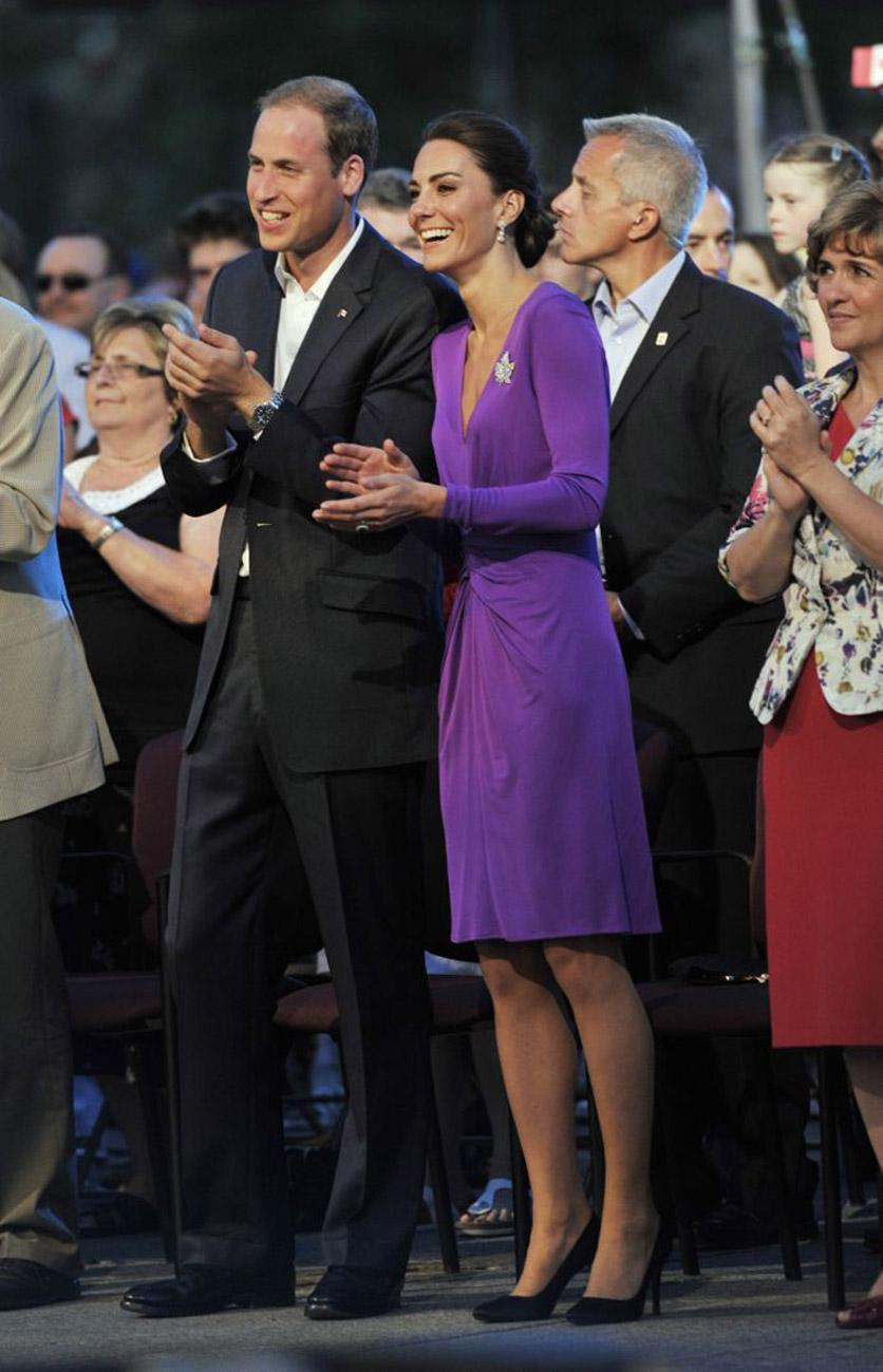 <p>Kate donned a regal purple wrap dress by Issa London for a day in Canada. She teamed the look with a silk Anya Hindmarch clutch and Prada heels. </p><p><i>[Photo: PA]</i></p>
