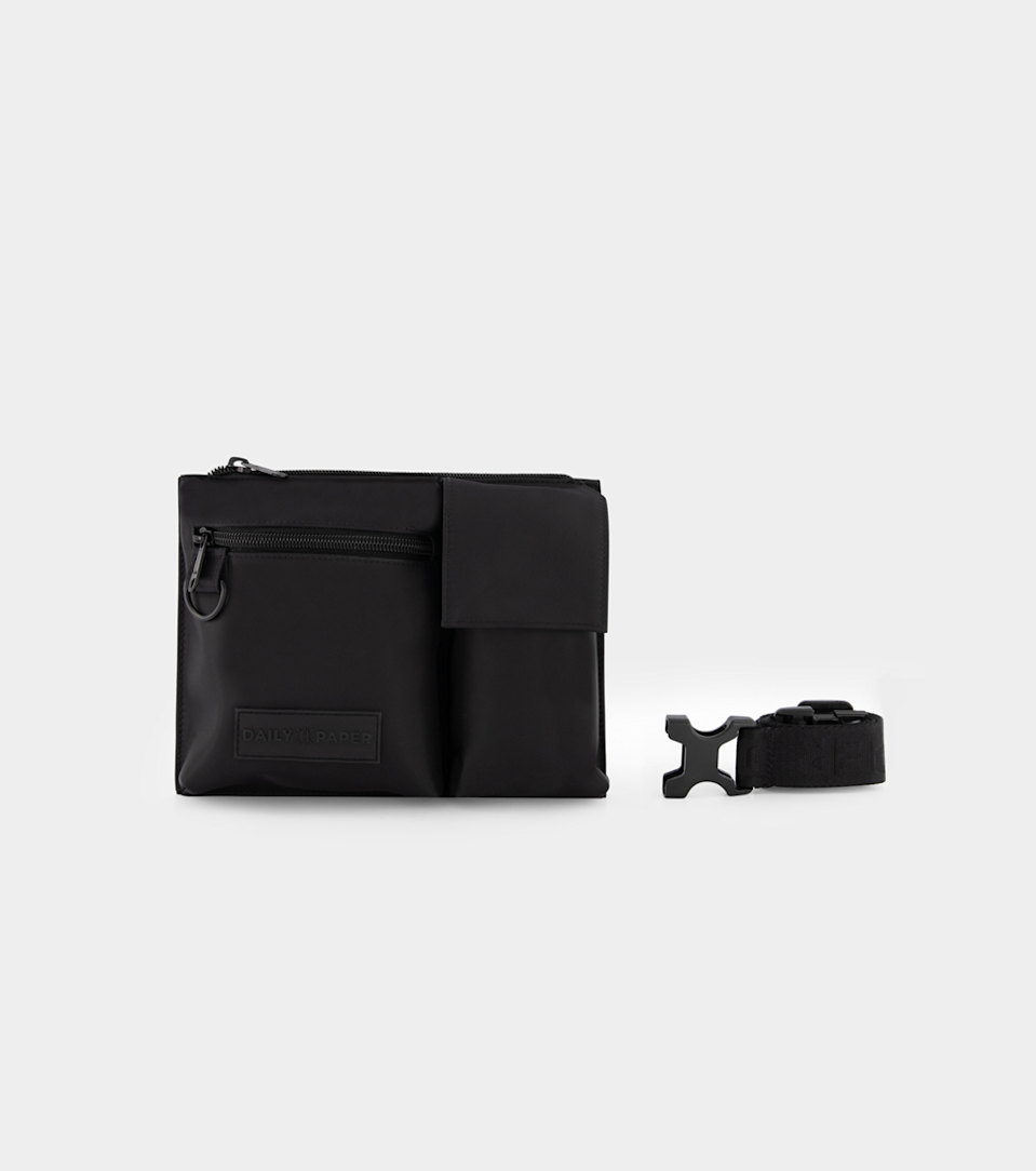 "<p><strong>Daily Paper</strong></p><p>dailypaperclothing.com</p><p><strong>43.00</strong></p><p><a href=""https://www.dailypaperclothing.com/collections/accessories/products/black-harec-waistbag"" rel=""nofollow noopener"" target=""_blank"" data-ylk=""slk:Shop Now"" class=""link rapid-noclick-resp"">Shop Now</a></p><p>No pockets necessary, when you have a compact waistbag built to tote day-to-day essentials. This understated rendition from Daily Paper is outfitted with numerous compartments equipped to hold keys, credit cards and even a phone. The multiway style can be worn slung over the shoulder or clipped around the waist, with a detachable branded strap included with the functional pouch. </p>"