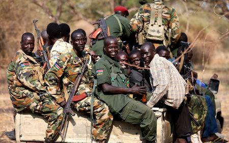 FILE PHOTO - South Sudan's rebels with weapons travel in a truck in a rebel-controlled territory in Jonglei State