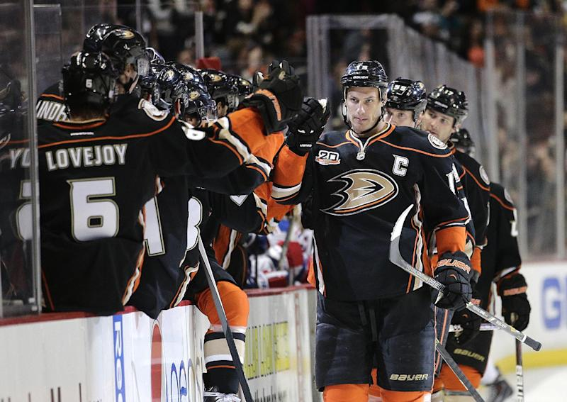 Anaheim Ducks' Ryan Getzlaf, right, celebrates his goal with teammates during the first period of an NHL hockey game against the New York Rangers on Thursday, Oct. 10, 2013, in Anaheim, Calif. (AP Photo/Jae C. Hong)