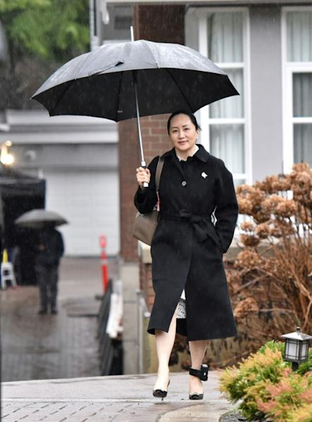 Huawei chief financial officer Meng Wanzhou leaves her Vancouver home to go to her extradition hearing on January 23, 2020; the case was adjourned