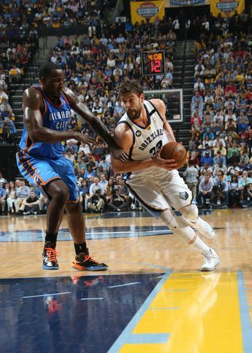 MEMPHIS, TN - MAY 11: Marc Gasol #33 of the Memphis Grizzlies drives under pressure during the Game Three of the Western Conference Semifinals between the Oklahoma City Thunder and the Memphis Grizzlies during the 2013 NBA Playoffs on May 11, 2013 at FedExForum in Memphis, Tennessee. (Photo by Layne Murdoch/NBAE via Getty Images)