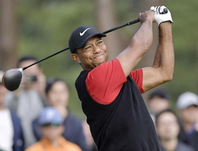 Tiger Woods tees off the 9th hole during the final round of the Zozo Championship, a PGA Tour event, at Narashino Country Club in Inzai, Chiba Prefecture, Japan