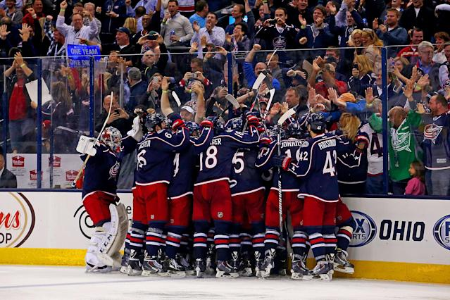COLUMBUS, OH - APRIL 23: Nick Foligno #71 of the Columbus Blue Jackets is congratulated by his teammates after beating Marc-Andre Fleury #29 of the Pittsburgh Penguins for the game winning goal during the overtime period in Game Four of the First Round of the 2014 NHL Stanley Cup Playoffs at Nationwide Arena on April 23, 2014 in Columbus, Ohio. Columbus defeated Pittsburgh 4-3 in overtime. (Photo by Kirk Irwin/Getty Images)