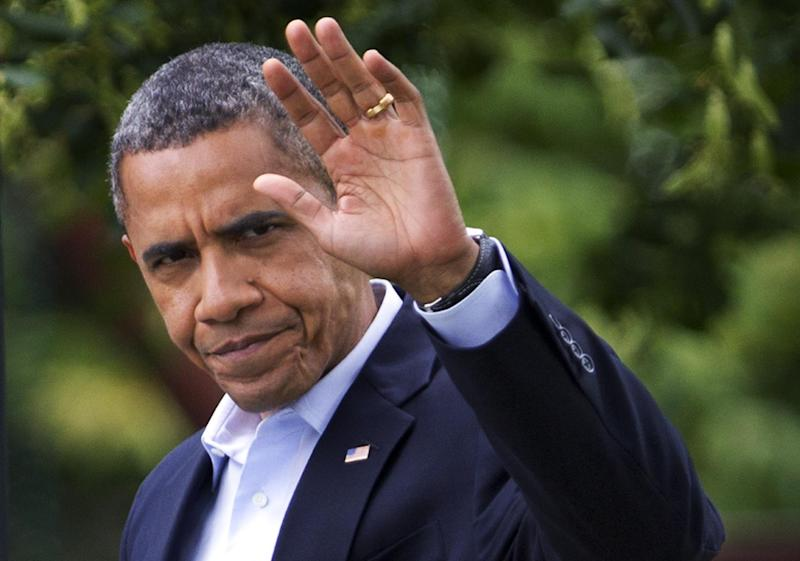 President Barack Obama waves as he leaves the White House in Washington for a trip to visit the families of victims of the shooting in Aurora, Colo., Sunday, July 22, 2012.  (AP Photo/Manuel Balce Ceneta)
