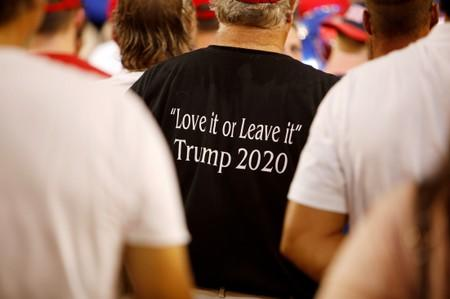 """FILE PHOTO: A supporter of U.S. President Trump wears a shirt with the message of """"Love It or Leave It"""" at a campaign rally in Greenville"""