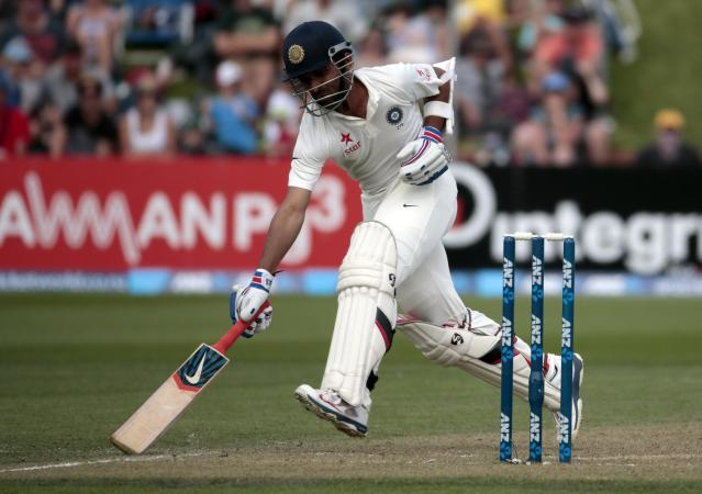 India's Ajinkya Rahane makes his ground against New Zealand during the first innings on day two of the second international test cricket match at the Basin Reserve in Wellington, February 15, 2014. REUTERS/Anthony Phelps (NEW ZEALAND - Tags: SPORT CRICKET)