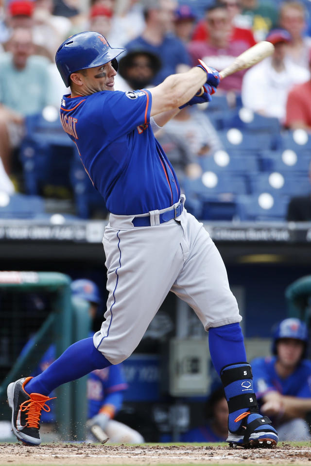New York Mets' David Wright follows through on an RBI-single off Philadelphia Phillies starting pitcher David Buchanan during the fourth inning of a baseball game, Monday, Aug. 11, 2014, in Philadelphia. (AP Photo/Matt Slocum)