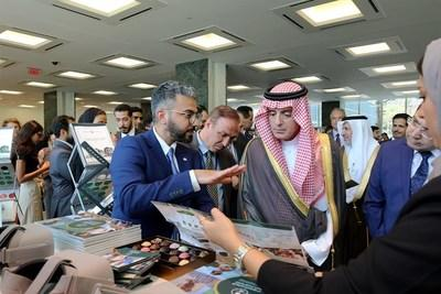 Saudi Minister of State for Foreign Affairs Adel al-Jubeir (right) is briefed on Saudi Development and Reconstruction Program for Yemen initiatives by SDRPY Communications Director Abdullah bin Kadasa at UN Headquarters in New York.