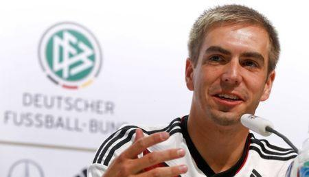 Germany's national soccer team player Philipp Lahm gestures as he addresses a news conference in the village of Santo Andre north of Porto Seguro July 11, 2014. REUTERS/Arnd Wiegmann