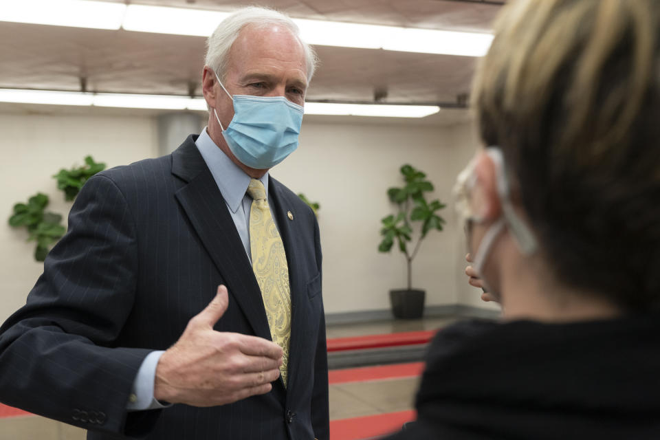 Sen. Ron Johnson, R-Wis., answers reporters after leaving the Senate floor, Tuesday, Jan. 26, 2021, on Capitol Hill in Washington. (AP Photo/Jacquelyn Martin)