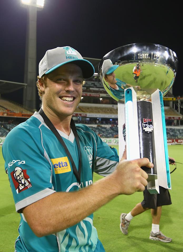 PERTH, AUSTRALIA - JANUARY 19: Alister McDermott of the Heats holds the winner's trophy after the Heat defeated the Scorchers in the Big Bash League final match between the Perth Scorchers and the Brisbane Heat at the WACA on January 19, 2013 in Perth, Australia.  (Photo by Robert Cianflone/Getty Images)