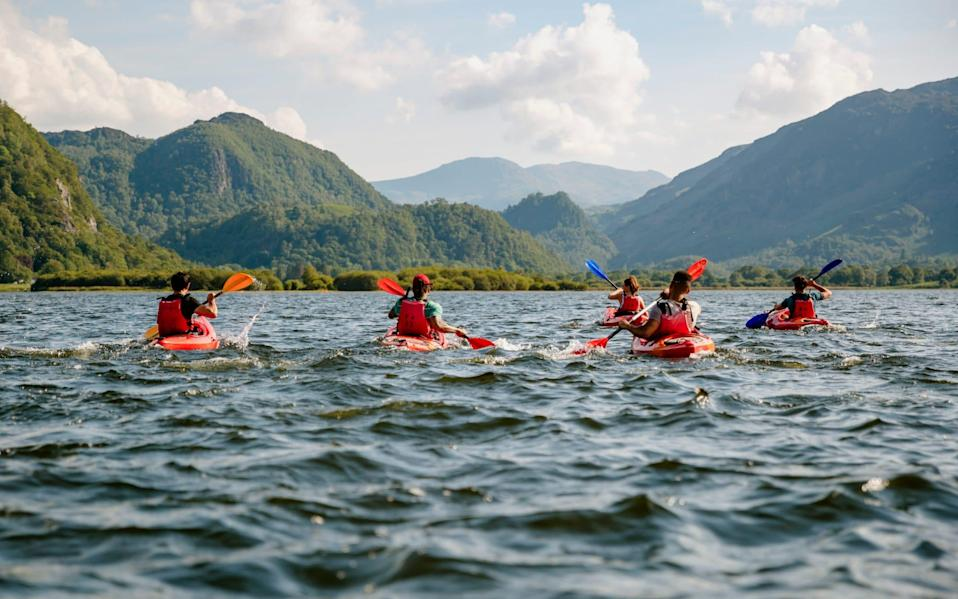 Friends learning To kayak - Getty