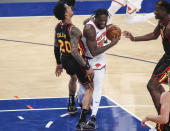 New York Knicks forward Julius Randle (30) drives against Atlanta Hawks forward John Collins (20) during the third quarter of an NBA basketball game Wednesday, April 21, 2021, in New York. (Wendell Cruz/Pool Photo via AP)