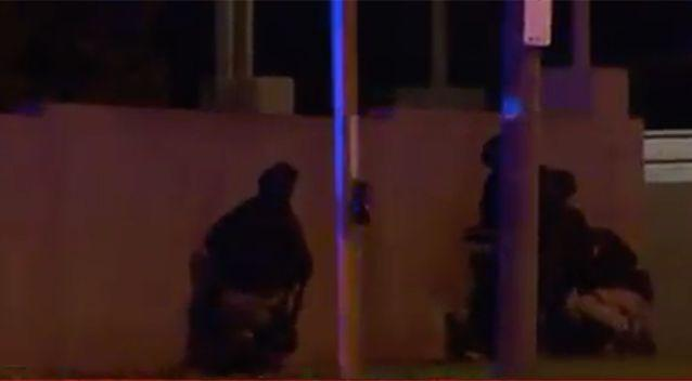 Officers at the scene during the siege. Photo: 7 News