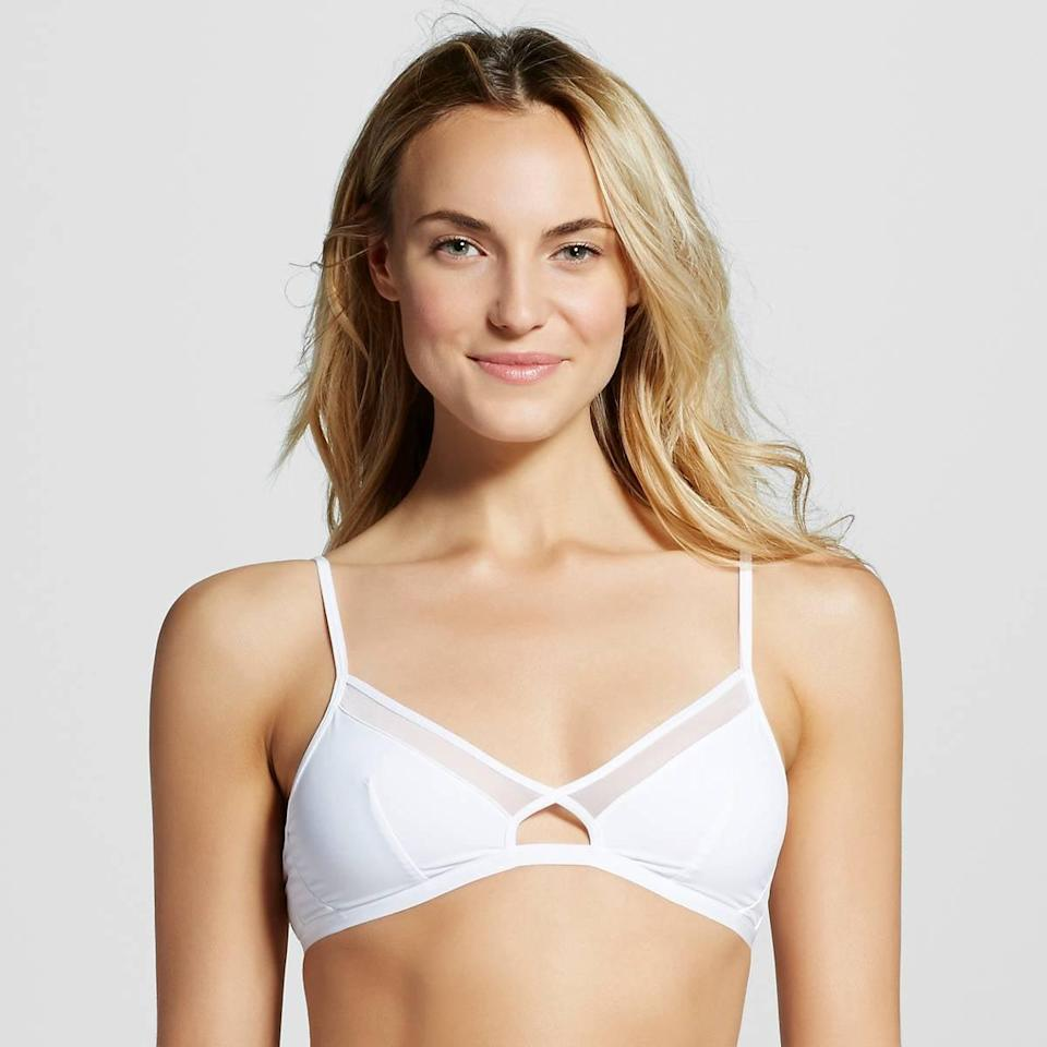 <p>The sheer panels are a modern detail on this <span>Xhilaration Cut-Out Micro Triangle Bralette</span> ($13).</p>