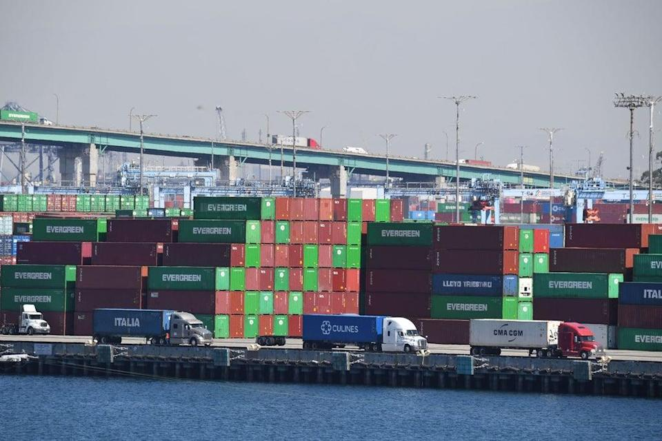 Trucks wait in line in front of containers at the Port of Los Angeles on October 14  (AFP via Getty Images)