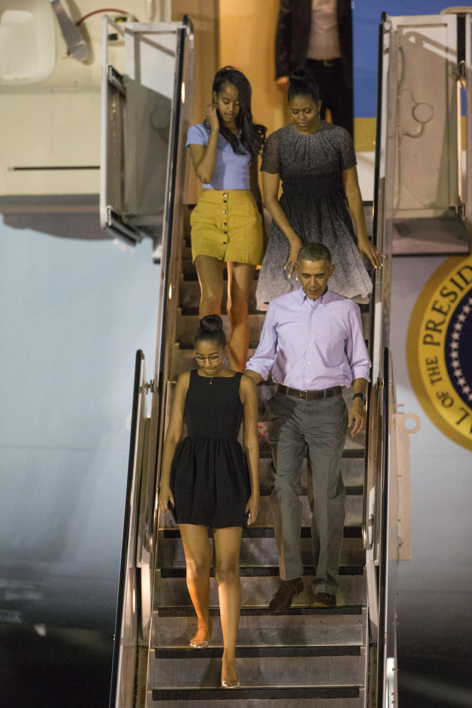 <p>While the weather in Washington, DC, has been unseasonably warm, the Obama family still decided to escape to an even warmer climate for the holidays. Touching down at Joint Base Pearl Harbor/Hickam in Honolulu, President Obama left his jacket on Air Force One while the first lady and Sasha and Malia took off their tights. </p>