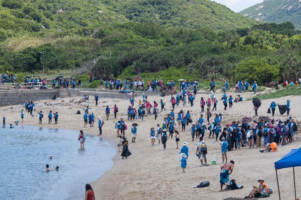 "Sunday's clean-up took place on Shek Pai Wan, near Sham Wan -- known as ""Turtle Cove""  — on Hong Kong's Lamma Island (AFP Photo/Anthony WALLACE)"