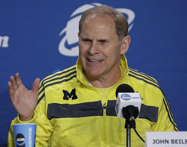 Michigan head coach John Beilein answers a question during an interview session for the NCAA Midwest Regional final college basketball tournament game Saturday, March 29, 2014, in Indianapolis. Michigan plays Kentucky in the final on Sunday, March 30, 2014. (AP Photo/David J. Phillip)