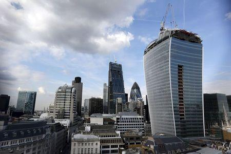 The Walkie Talkie skyscraper (R) is seen during its construction in central London, in this September 3, 2013 file photo. REUTERS/Stefan Wermuth/Files