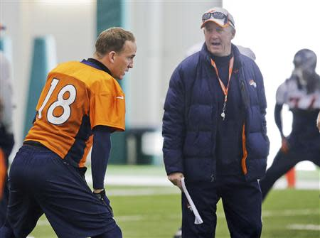 Denver Broncos quarterback Peyton Manning talks with head coach John Fox during their practice session for the Super Bowl at the New York Jets Training Center in Florham Park, New Jersey January 30, 2014. REUTERS/Ray Stubblebine