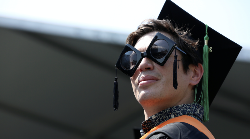 A graduate of The City College of New York stands in his seat at his commencement ceremony in Manhattan on May 31, 2019. (PHhoto: REUTERS/Gabriela Bhaskar)