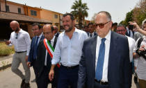 Italian Deputy Premier and Interior Minister, Matteo Salvini, arrives in Mineo, near Catania, southern Italy, Tuesday, July 9, 2019. Italy's hard-line interior minister has closed a migrant center in Sicily that he says was the largest in Europe as he underlined the decrease in migrant arrivals since he took over a year ago. Matteo Salvini has told reporters in Mineo, Sicily that that the number of migrants in centers is down from 182,000 a year ago to 107,000 now. (Orietta Scardino/ANSA via AP)