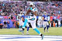Dec 20, 2015; East Rutherford, NJ, USA; Carolina Panthers wide receiver Ted Ginn Jr. (19) scores a touchdown against the New York Giants during the third quarter at MetLife Stadium. Mandatory Credit: Brad Penner-USA TODAY Sports