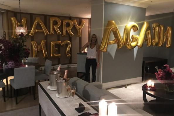 """Oliver Curtis proposed to his wife for the second time on Friday night with some balloons reading, """"Marry me? Again."""""""