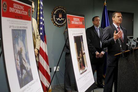 Special Agent in Charge of the FBI's Boston Division, Lisi, is joined by Portland, Maine Police Chief, Sauschuck at a news conference in Boston