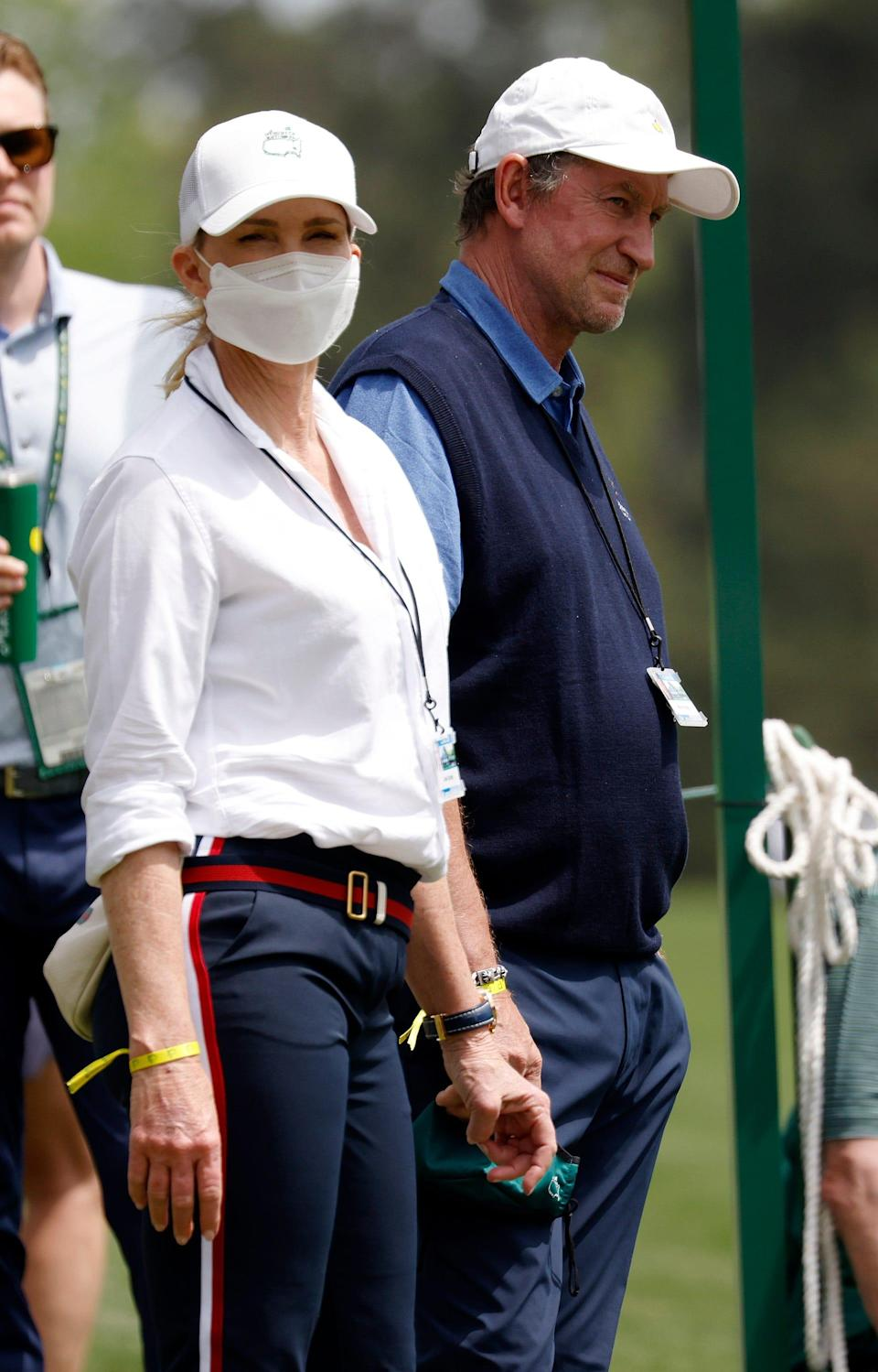 Wayne Gretzky and his wife, Janet, watch Dustin Johnson on No. 13 during Thursday's first round for the Masters at Augusta National Golf Club, Thursday, April 8, 2021, in Augusta, Georgia.